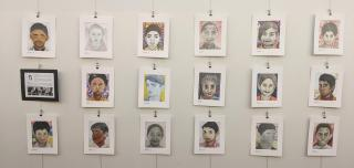 Image of 17 portraits hanging on a wall